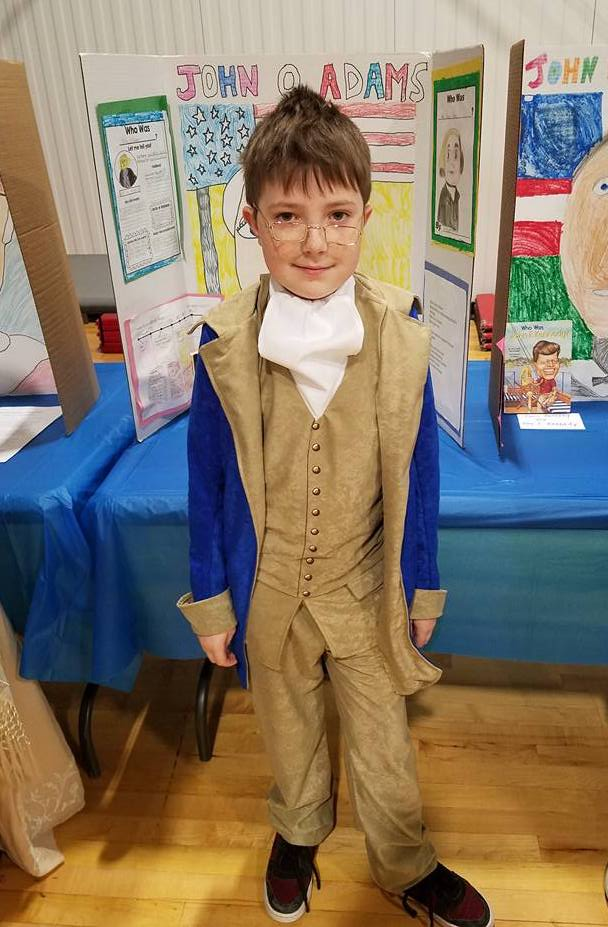 Elementary student dressed as John Quincy Adams for a school project